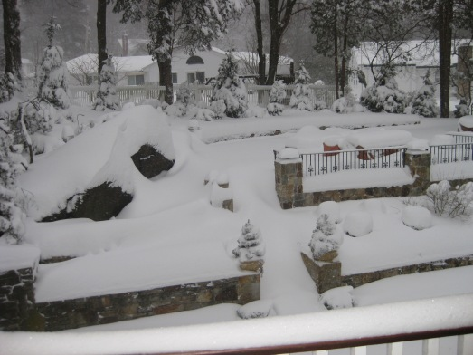 Snow obscured patio furniture...