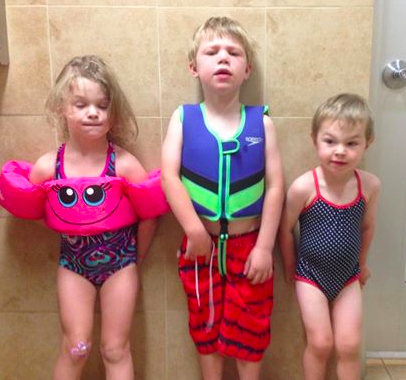When mom finds only one little boy bathing suit in the bag, she'll improvise.