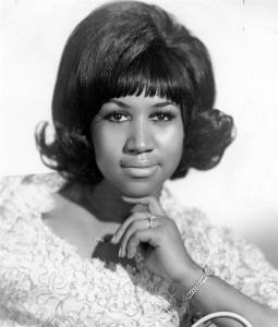 Aretha looking all fetching-- crooning about feeling like a natural women, which is really just a function of  her neonatal endocrinology... but those make for awkward song lyrics.
